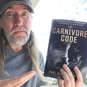 Carnivore diet feature image with Anthony Metivier holding The Carnivore Code by Paul Saladino