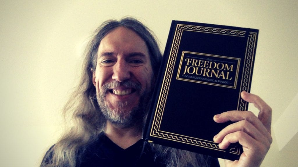Anthony Metivier holding The Freedom Journal
